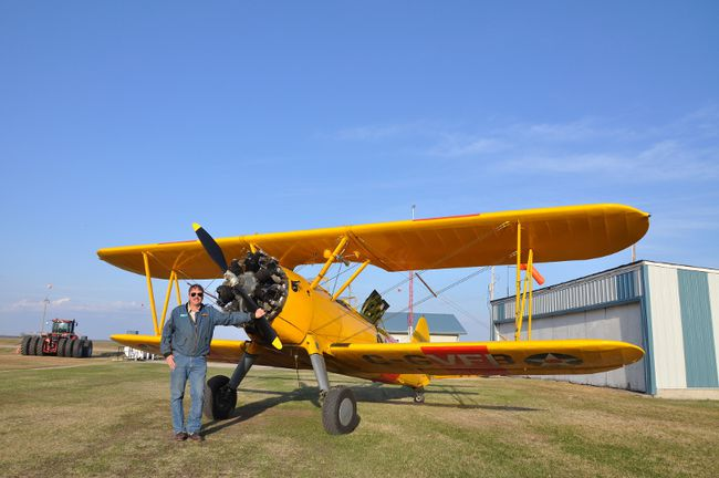 Colin Craddock stands beside his 1941 Stearman.   A Tiger Moth (1941), Cornell, and possibly a Harvard will attend the Carman Airport Day this year, courtesy of the the British Commonwealth Air Training Plan Museum. Rides will be available, although the seats are going fast. The annual Airport Day is set for June 10 this year at the Carman (South) Airport. (SUPPLIED PHOTO)