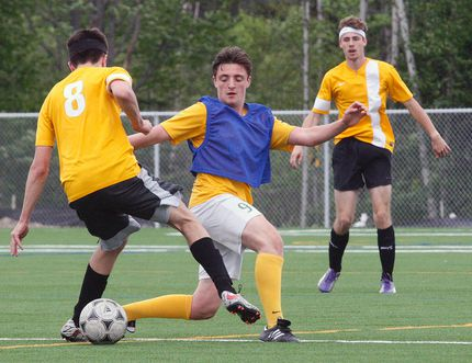 The St. Joseph-Scollard Hall Bears dominated the Korah Collegiate Colts of Sault Ste. Marie to claim the 2018 NOSSA 'AA' seniors boys championship at the new Nipissing University artificial field, Friday. In the photo above, the Bears' Matteo Pavone, blue pinny, defends against a Korah player. Team members include: Juan Arias Iglesias, Adam Courchesne, Stephen Crea, Jaymeson Cundari, Dylan D'Agostino, Ian Denomme, Nathan Desrosiers, Conor Doyle, Matteo Farella, Payton McLeod, Jared Mechefske, Matteo Pavone, Michael Pettella, Nolan Reynolds, Dylan Simon, Shkaabewis Tabobondung, Jacob Wall, Spencer Waltenbury, Riley Yakabuskie, student trainer Lucas Dunne, coaches Carlo Celebre, Robert Pavone, Andrew Hazelwood and Greg Janveau. Dave Dale / The Nugget