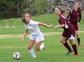 Jordin Rancourt, left, of Marymount Regals, eludes Emma Caruso, of Algonquin, during girls NOSSA soccer semifinal action in Lively, Ont. on Friday June 1, 2018. The Regals won 3-0, but lost to Confederation later in the day. John Lappa/Sudbury Star/Postmedia Network