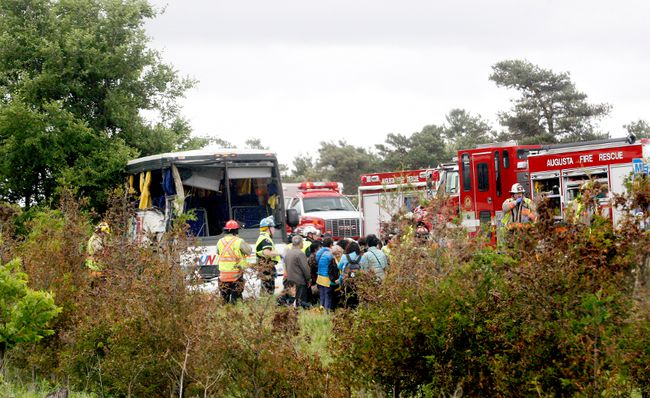 Firefighters help passengers of a bus involved in a serious collision west of Prescott on Highway 401 on Monday, June 4, 2018 near Prescott, Ont. (FILE PHOTO)