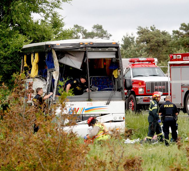 Firefighters and police officers respond to a serious collision involving a bus west of Prescott on Highway 401 on Monday. (MARSHALL HEALEY/Special to The Recorder and Times)