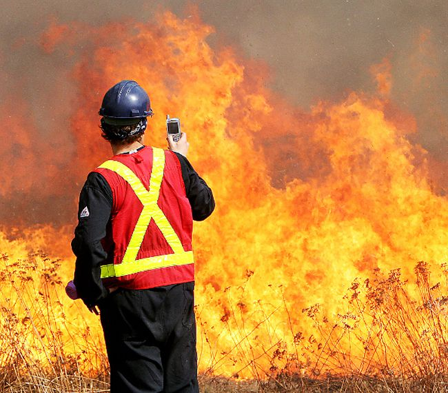 A crew of 27 people from Nova Scotia's Department of Natural Resources was in Alberta May 27 to help control wildfires sweeping across parts of the province.