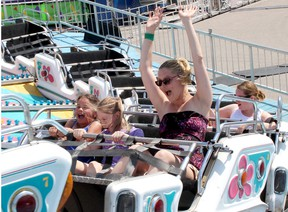 Emickenzie Alliett, 8, left, Trinity Toth, 10, and Megan Franko were enjoying taking a trip on the Polar Express ride at the Kinsmen Fair in Chatham on June 11, 2016. (File photo/Postmedia Network)