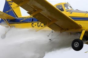 Travis Karle demonstrates how his crop dusting plane can be re-tasked to help local fire departments.