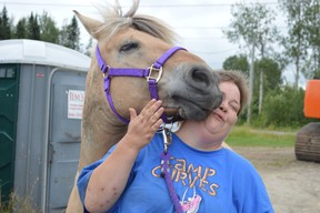Program mentor Cheryl Bruce gets a kiss from a horse at Verdiel Farms in Hanmer, home to the Whinnying in Life program. (Jim Moodie/Sudbury Star)