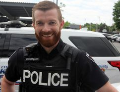 Const. Walter O'Connor at Kingston Police Headquarters in Kingston, Ont. on Wednesday June 6, 2018. On June 4 O'Connor was hoisted into a building building to held an elderly man escape. Steph Crosier/The Whig-Standard/Postmedia Network