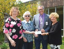 Photo by KEVIN McSHEFFREY/THE STANDARD Geraldine Robinson - St. Joseph's General Hospital Auxiliary president, Faye Steel - auxiliary treasurer and Brenda Farquhar - auxiliary gift shop convener, present the organization's cheque for $32,326 to hospital CEO Pierre Ozolins.