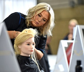 Delaney Hodge, a Grade 12 at Archbishop Jordan Catholic High School, competes in hairstyling during the Skills Canada National Competition at the Expo Centre in Edmonton on June 4.  Ed Kaiser/Postmedia Network