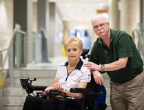 Tim Nolan, who is legally blind, and his wife, Kim, who requires the use of a wheelchair, are photographed together in Hamilton, Wednesday. THE CANADIAN PRESS/Peter Power