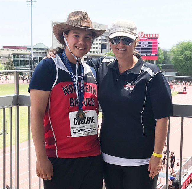 Brent Couchie, left, poses with coach Nicole Cartwright after winning OFSAA gold in the midget boys javelin event in Toronto, Friday. Kaitlyn Fitzpatrick Photo