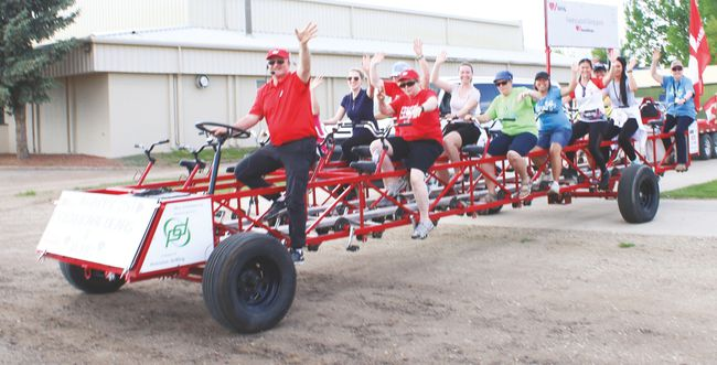 Local participants in the Heart and Stroke Foundation Big Bike ride wave as they depart from the parking lot outside the Cultural-Recreation Centre May 24. This was the 25th year local residents have taken part in the fundraiser. Jasmine O'Halloran Vulcan Advocate