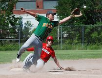 Scollard Hall Bears third baseman Brad Hubley reaches for a high throw while Parker Hamelin of the Chippewa Raiders slides into third on an RBI double during the first inning of NDA semifinal baseball action on the Veterans Park diamond, Friday. Chippewa held on for a 6-5 win to advance to the championship final against the Algonquin Barons Monday at 5 p.m. Algonquin, the defending champions, eliminated the West Ferris Trojans 11-3 in the early semi. Dave Dale / The Nugget