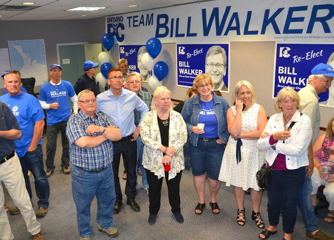 Bill Walker along with supporters, family and friends, watches election results come in at his campaign office in Owen Sound on Thursday evening. (Rob Gowan The Sun Times)