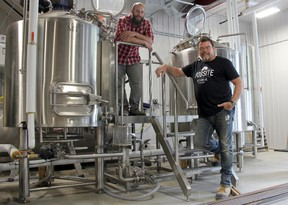 Partners Phil Buhler, left, and Dave Oldenburger seen at their brewery, Jobsite Brewing Co., on Cambria Street. Their goal is to open their business within the next month and launch with four variety of craft beers. JONATHAN JUHA/THE BEACON HERALD/POSTMEDIA NETWORK