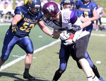"""Two Sault Sabercats close in on a Waterloo Predators player during third-quarter Ontario Football Conference action on Saturday at Superior Heights Collegiate and Vocational School. Waterloo won 8-7. The junior varsity Sault Sabercats downed Waterloo 22-13. Nick Pagnotta had 17 carries for 260 yards and three touchdowns. Tyler Brechin threw for 117 yards and ran for 38 yards. Ethan Fawcett had two interceptions. """" It was a good effort by the boys today,"""" said coach Jim Monico in an email. """"(They) bounced back nicely from last week and increased the intensity."""""""