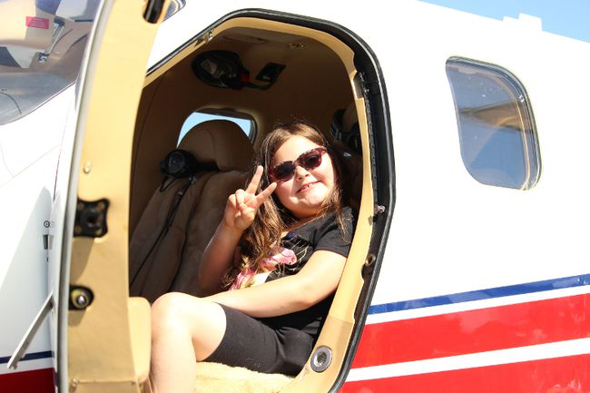 Makenna Mayer smiles as she sits in an airplane at Young Eagles Day at Victor M. Power Airport on Saturday, June 9 in Timmins. About 200 children visited the venue, learning about different aircrafts and viewing the city while in an airplane in the sky.