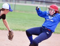 Randi Shuker (right) of the MDHS varsity girls slo-pitch team slides in safely to third base during semi-final action against South Huron, a 15-10 win. ANDY BADER/MITCHELL ADVOCATE