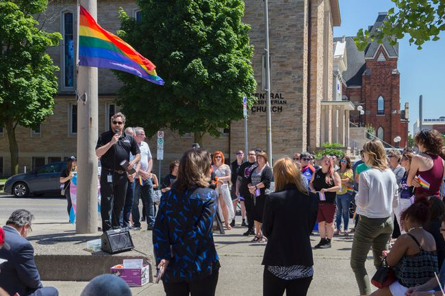 Brantford Mayor Chris Friel addresses the crowd in front of city hall before raising the Pride flag on Monday. (Alex Vialette/The Expositor)