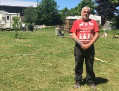 Scott Drader has set up five trailers on his four-acre Napanee property to house local homeless individuals and families. The town has notified him that he is violating the zoning bylaw that governs his property. (Meghan Balogh/The Whig-Standard)