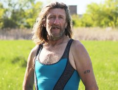 Meghan Balogh/The Whig-Standard John Clark stands in a field outside of his campsite. Clark has been homeless since October 2017 and is one of many who live in a forested area in Napanee.