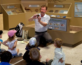 Ian MacAlpine/The Whig-Standard Mark Badham, curator of the Miller Museum of Geology at Queen's University, leads his popular dinosaur class for kindergarten students at the museum on Monday. Badham is retiring at the end of June.