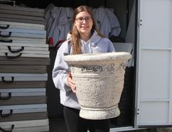 Kimberly Caron, an Urban Park coordinator, pulls out a flower pot from one of the storage units where the Downtown Timmins Business Improvement Association has materials to set up for the Urban Park. This year, the Urban Park is kicking off with a five-day start-up during the week of Stars and Thunder in order to provide some free family events for those in the downtown area during the festival.