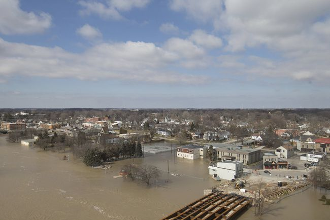 A view of the flooding from the Boardwalk apartment building in downtown Chatham, Sunday, Feb. 25. Floodwaters damaged properties in Chatham and Thamesville. As of May 31, 16 residents from the two communities had applied to the Ontario government for disaster recovery assistance because of flooding. Dax Melmer/Windsor Star/Postmedia Network