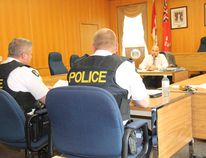 Staff Sergeant Dean Duchrow and Inspector Stephan Neufeld address Deputy Mayor Ron Gervais at the Pembroke Police Services Board meeting on May 30.