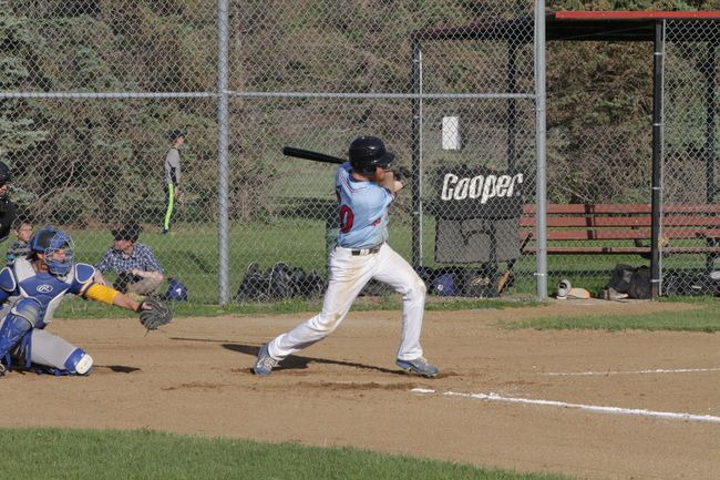 Travis Friesen drives an RBI double into the outfield at the Winkler Recreation Complex on June 12, 2018. (THOMAS FRIESEN, Winkler Times)