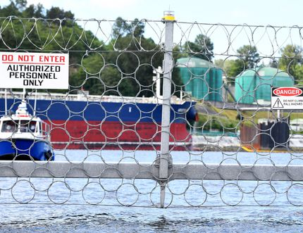 A security vessel patrols the fence of Kinder Morgan's Trans Mountain marine terminal, in Burnaby, B.C.