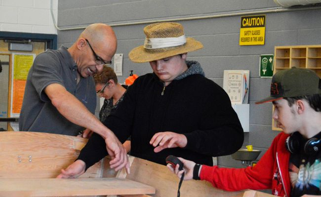 Teacher David Vine, left, assists students Quentin Bloemendal, middle, and Joe Le Blanc, right, during the Boats and Bikes class at Strathroy District Collegiate Institute. (Louis Pin/Postmedia News)