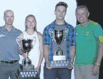 Canmore Collegiate's Amanda Graham (centre) and George Reed pose with their top athlete awards flanked by Kay and Gary Anderson, sponsors of the award, and high school athletic director Darren Anderson on Thursday.