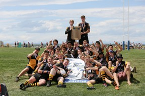 Daniel Dixon, centre, leads the charge against The Strathcona Tweedsmuir Spartans during the provincial rugby championships on in Calgary. Dixon, scored two tries during the match, to help secure the gold medal.