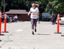 Kayla MacDonald crosses the finish line with a smile at the end of her 21.1-kilometre run that was for a class at St. Mary. (Jonathon Brodie/The Recorder and Times)