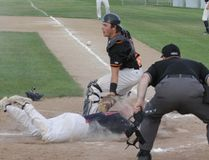 Pembina Valley Orioles catcher Robi Lewarne attempts to make a play at the plate against the Elmwood Giants at Buhler Park Wednesday, June 13. (THOMAS FRIESEN, Morden Times)