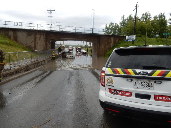 Submitted photo Quinte West OPP and Quinte West Fire responded to Sidney Street in Trenton Ward after Wednesday evening's sudden downpour of rain. Two vehicles had become stranded as the storm drains backed up. There were no injuries reported in the incident.