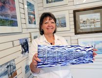 Gayle Halliwell showcases one of her paintings during the Wave Interlake Artists' Tour in 2017.