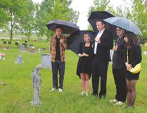 The cast and crew of Abracadavers were in Nanton May 31 to shoot a scene for the web-based series. The production, made up of emerging artists, is shooting throughout Alberta, as well as some locations in British Columbia. In this scene, the character Chris, played by Griffin Cork, middle, visits the grave of his mom, who died in a freak hair salon chair accident. From left in the photo are Franco Correa, Emma Houghton, Cork, Jordan Wright and Courtney Charnock. Stephen Tipper Nanton News