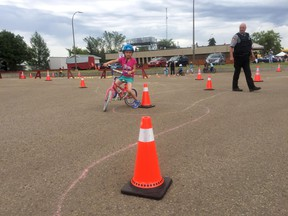 Lots of Fort kids got a free bike tune up from Winner's Way and learned the rules of the road on June 9 as part of the RCMP's bike rodeo at Families First.