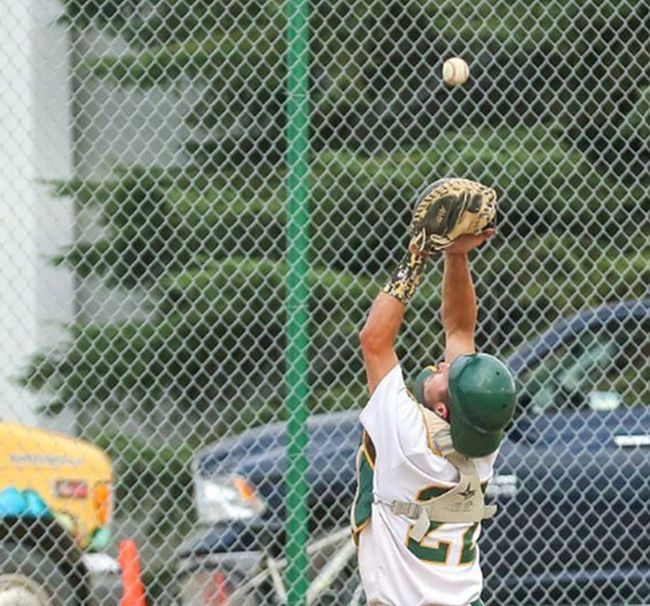 Sherwood Park Athletics catcher Mike Falkins tracks down a foul ball. The A's will be hosting a special community appreciation game on Friday at Centennial Park.  Photo courtesy Two Point Photography