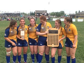 The seven-time Metro League champion Bev Facey Falcons senior girls rugby team captains pose with the consolation trophy at the recent provincials in Calgary. Photo Supplied