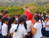 On a recent mission trip to Nicaragua, a group of area residents decided to raise $5,000 on their return to Canada to help a community kitchen in Managua purchase a proper oven. Pictured, Elly Schreuders, one of the youth that participated in the mission trip, meets a group of local girls who attend the school next door to the community kitchen. (Submitted photo)