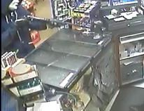 A security video still of the armed robbery at Mac's on June 14. (RCMP photo)