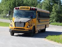 Wauzhushk Onigum Nation's 100 per cent electric school bus rolls into the parking lot of the Community Development Centre on Wednesday, June 13. Wauzhushk Onigum is the first First Nation in Ontario to have an electric school bus on the road. KATHLEEN CHARLEBOIS/DAILY MINER AND NEWS