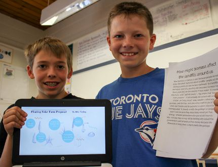 Zorra Highland Park Public School students Riley Vording and Camden Munro tackle the local issue of a proposed dump in Beachville using science and electricity. (Chris Funston/Sentinel-Review)