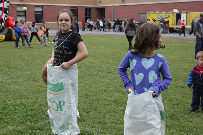 <p>Emma White and Brianna O'Quinn compete in a sack race on Thursday June 14, 2018 in Cornwall, Ont. Central Public School celebrated 200 years with a family barbecue and lots of fun activities.</p><p>