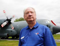 "Chris Colton, the soon-to-be-retired director of the National Air Force Museum of Canada, stands before a CC-130 Hercules in the museum's air park. The former Hercules pilot said he's enjoyed his ""wonderful career"" with the facility."
