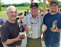 The Apple Pie Trail Ciderfest concluded 10 days of cider-tasting at area ciders on Sunday. At Georgian Hills Vineyards, home to Ardiel Cider House, business partners Robert Ketchin, left, John Ardiel, and his son, Greg Ardiel, hold four ciders containing alcohol, made from Ardiel-grown-apples, on Saturday. (Scott Dunn/The Sun Times)