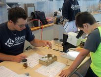 Devin Burns, right, looks at a water penny through a microscope with Josh Filion from the St. Lawrence River Institute at the Eco Heroes event on Saturday. Alan S. Hale/Cornwall Standard-Freeholder