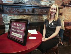 """Ashley Clark is the organizer of Human Bookshelf, as well as one of the """"books"""" that people could sit down with during the event at the Tir Nan Og on Saturday. (Meghan Balogh/The Whig-Standard/Postmedia Network)"""